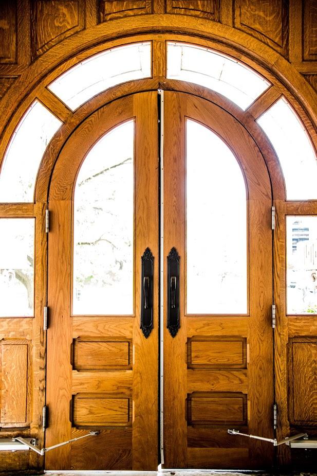 golden wooden door with arch-top windows